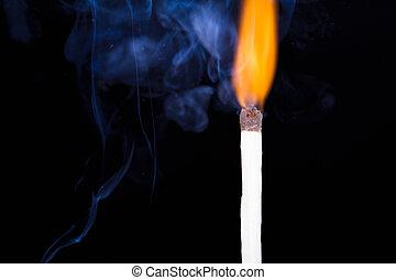 Burning Match and Smoke