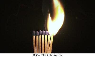 Burning match in the dark