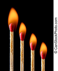 Burning match isolated on black background