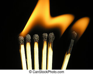 Burning matches on black background