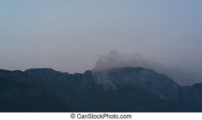 Burning mountain at dusk, Montenegro, time lapse
