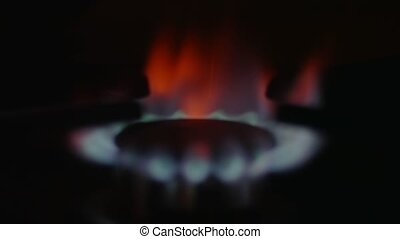Burning natural gas in dark, shift from defocus to focused...