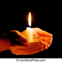 candle - Burning of the candle in a hand in darkness