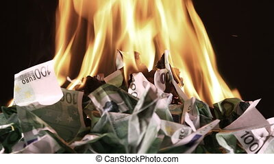 Burning one hundred Euro banknotes rotate - Bunch of burning...
