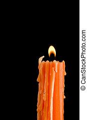 Burning orange candle