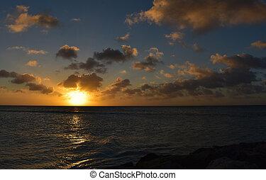 Burning Orange Sun Setting Over the Ocean in Aruba