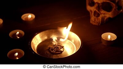Burning pentacle on altar close up footage