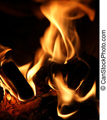 pieces of wood with flames and fire