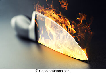 Burning professional kitchen knife - Closeup of burning...