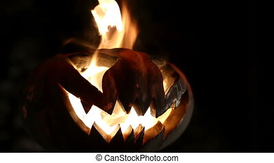 Burning pumpkin on Halloween. Looped