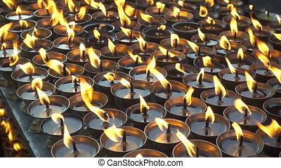 Burning ritual candles in nepali temple. Kathmandu, Nepal.