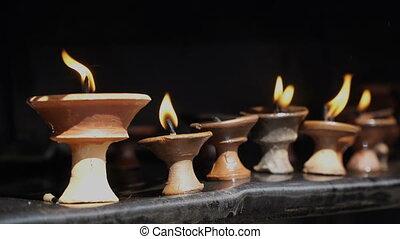 Burning ritual candles in nepali temple