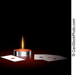 burning small candle and cards - on a black background are...