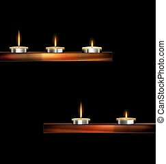 burning small candles - dark background and burning candles...