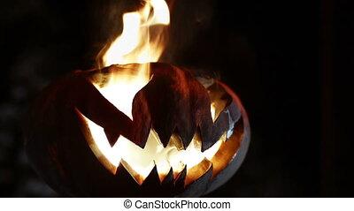 Burning smile pumpkin on Halloween. Looped