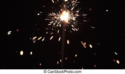 Burning christmas sparkler (bengal fire) on black background. HD slowmotion video with shallow dof