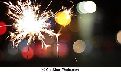 Burning Sparkler On Bokeh Light Background