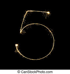 burning sparkler stick and writing sparkling text . number five