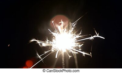 Burning sparklers. A sense of celebration. Close