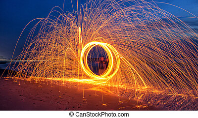 Burning steel wool spinned