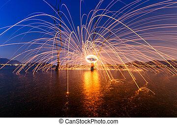 Burning Steel Wool spinning, Circle fire at sunset
