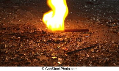 Burning stick close-up in slow motion