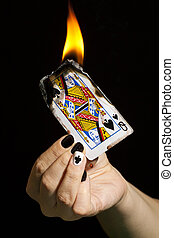 Burning the queen of spades.