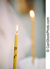 burning thin candle during christening