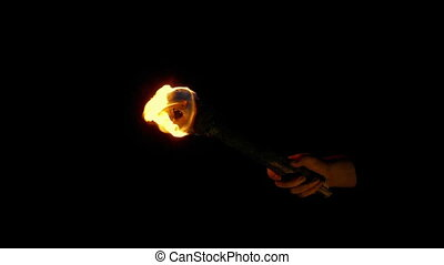 Burning Torch Is Held Up Then Goes Off - Wooden burning...