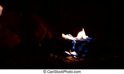 Burning torch lays on ground in the dark. Low key, slow mo, ...