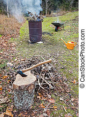 Burning twigs and branshes in a barrel during autumn