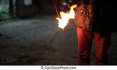 Burning wand in the hands of slow motion