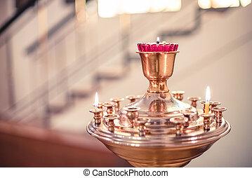 Burning wax candles in an orthodox church