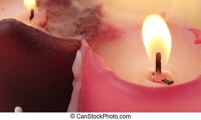 Burning wax candles - Rotation of three burning wax candles