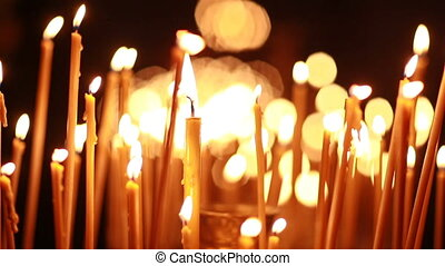 Burning wax candles with a beautiful bokeh