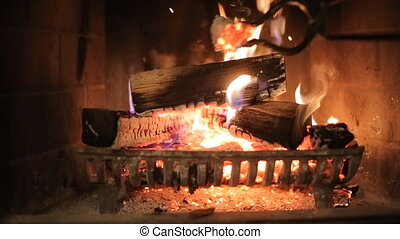 Burning wood in stone fireplace