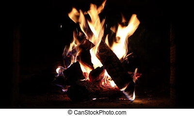 Burning Wood In The Fireplace - Warm cozy burning fire in a...