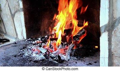 burning wood on fireplace