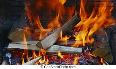 Burning wood blocks over ember