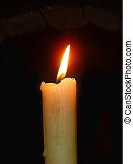 Burninging candle on dark background