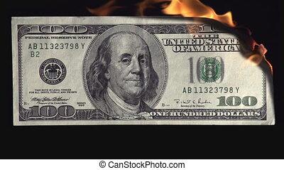 $ 100 U.S. dollars burning on a black background