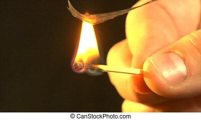 burnt 8mm film - close-up burning pieces of super-8 film