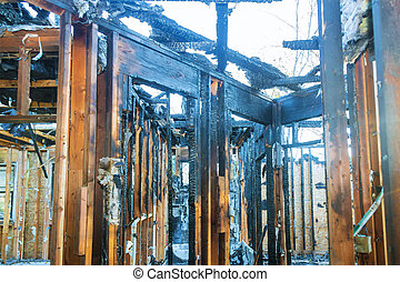 Burnt black house after fire damaged interior details arson from a home