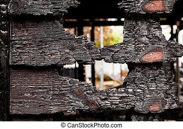 Burnt broken wood wall