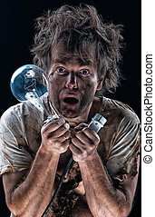 Burnt man - Portrait of burnt man with light bulb and...