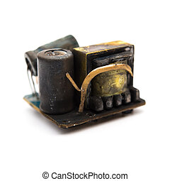 burnt out core of a mobile recharger on white background