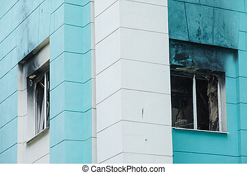 burnt out window in high-rise building. Fire in the house