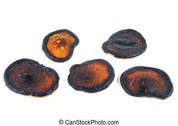 Burnt pancakes isolated on white background