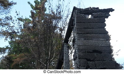 Burnt remains of house fire. - Charred remains of structure...