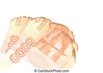 burnt russian banknotes on white background closeup